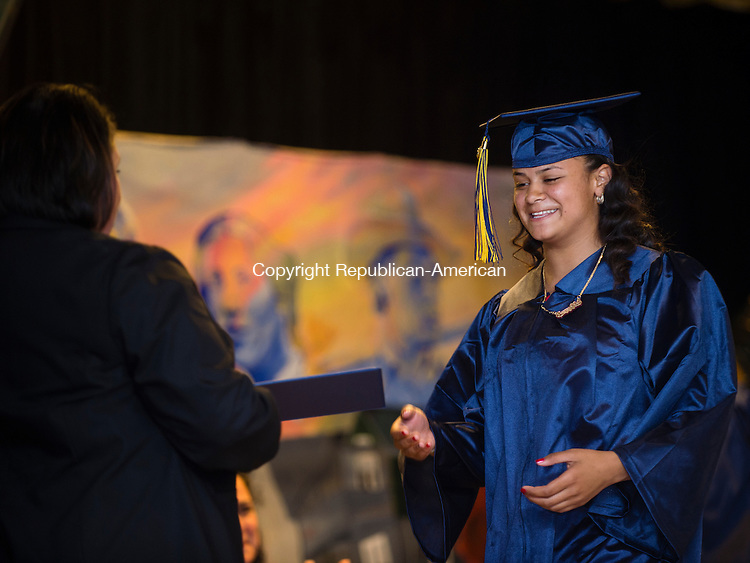 WATERBURY, CT- 8 June 2016-060816EC04-  Janelle Rosado receives her diploma from The State Street School in Waterbury Wednesday. Five seniors received their diplomas inside the Police Activity League building. Erin Covey Republican-American
