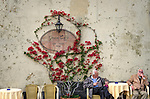 Two elderly locals having a discussion at the Gran Cafe in the town of Amalfi on the Amalfi Coast in Italy.