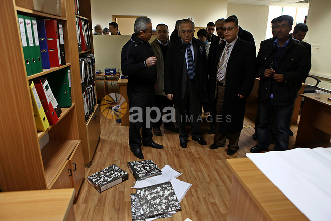Palestinian Prime Minister Salam Fayyad, left, visits the offices of al-Watan TV after an Israeli army pre-dawn raid in the West Bank city of Ramallah, Wednesday, Feb. 29, 2012. A Palestinian broadcaster says Israeli troops raided his TV station, seizing transmission equipment, computers and documents. Computer screen on right shows an Israeli soldier during the raid. Photo by Mustafa Abu Dayeh