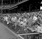 Pittsburgh PA: View of fans waiting for players to sign autographs before the start of the HYPO Charity game between the Pittsburgh Pirates and Milwaukee Braves at Forbes Field.<br /> <br /> The money raised by HYPO (Help Young Players Organize) was used to help local communities buy equipment and build ball fields.