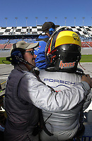 .Before taking over for the run to the checkered flag Michael Schrom gets well wishes from teammate/owner Kevin Buckler. ..