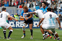 Rugby, Torneo delle Sei Nazioni: Italia vs Inghilterra. Roma, 14 febbraio 2016.<br /> Italy's Gonzalo Garcia is challenged by England's Ben Youngs, left, Jack Nowell and Billy Vunipola, right, during the Six Nations rugby union international match between Italy and England at Rome's Olympic stadium, 14 February 2016.<br /> UPDATE IMAGES PRESS/Riccardo De Luca