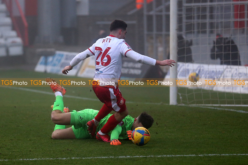 Tom Pett of Stevenage is denied by Freddie Woodman of Swansea City during Stevenage vs Swansea City, Emirates FA Cup Football at the Lamex Stadium on 9th January 2021