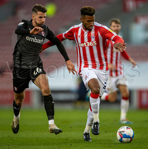 31st October 2020; Bet365 Stadium, Stoke, Staffordshire, England; English Football League Championship Football, Stoke City versus Rotherham United; Tyrese Campbell of Stoke City under pressure from Daniel Barlaser of Rotherham United