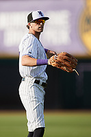 Duke Ellis (11) of the Winston-Salem Dash warms up in the outfield prior to the game against the Greensboro Grasshoppers at Truist Stadium on June 15, 2021 in Winston-Salem, North Carolina. (Brian Westerholt/Four Seam Images)