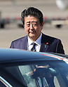 Prime Minister Shinzo Abe and wife Akie arrive in Japan after attending the UN General Assembly