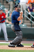 June 26, 2009:  Home plate umpire Rob Healey makes a call during a game at Frontier Field in Rochester, NY.  Photo by:  Mike Janes/Four Seam Images