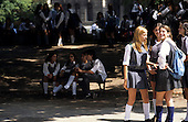 Buenos Aires, Argentina. Schoolgirls chatting outside school.