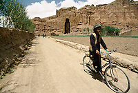 Bicycle ride in the front of the Bamiyan Buddha of 54 meters high, in 1995.These magnificent colossal statues, created during the 3rdâ4th centuries A.D., attracted pilgrims for centuries, far beyond the time when Buddhism languished in India following the disastrous visitation of the Hephthalite Huns in the 5th century, the subsequent resurgence of Hinduism, and the arrival of iconoclastic Islam in the 7th century.The entire niche was once covered with paintings dating from i he late 5th to the early 7th centuries.