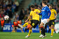 SYDNEY, AUSTRALIA - JULY 31, 2010: Gentzoglou Savvas of AEK Athens kicks the ball during the match between AEK Athens FC and Glasgow Rangers at the 2010 Sydney Festival of Football held at the Sydney Football Stadium on July 31, 2010 in Sydney, Australia. (Photo by Sydney Low / www.syd-low.com)