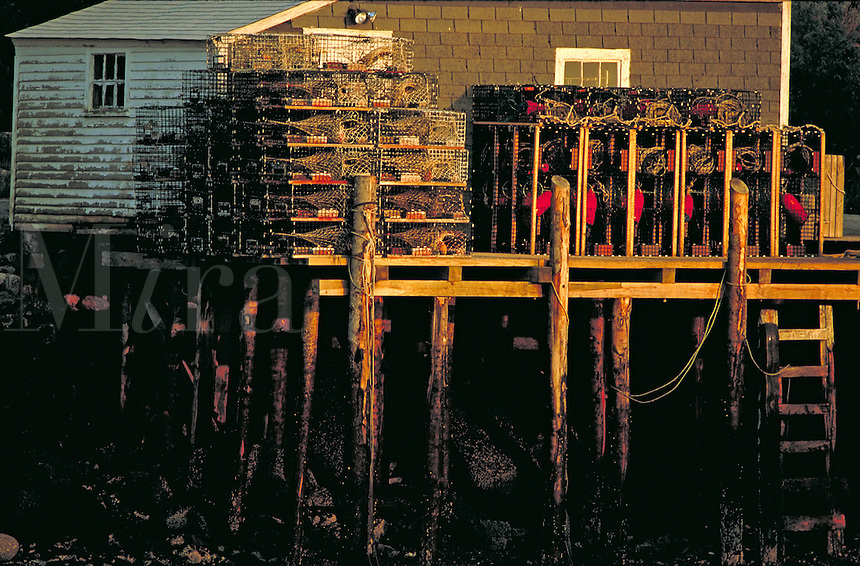 lobster traps on dock while tide is out, tidal change over 10 ft. Maine, coastal.