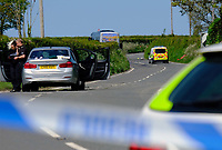 Pictured: The coach that was involved in a crash seen n the distance while emergency services remain on the A478 road near Llandissilio in Wales, UK. Monday 17 May 2021<br />Re: Emergency services are the scene of a serious collision on the A478 near Llandissilio in Pembrokeshire, Wales, UK.<br />The collision involved a motorcar and a bus carrying school children and was reported to police at 8.35am.<br />A number of children received minor injuries with two taken to hospital by ambulance with what are described as minor injuries.<br />The road is currently closed and officers remain at the scene.