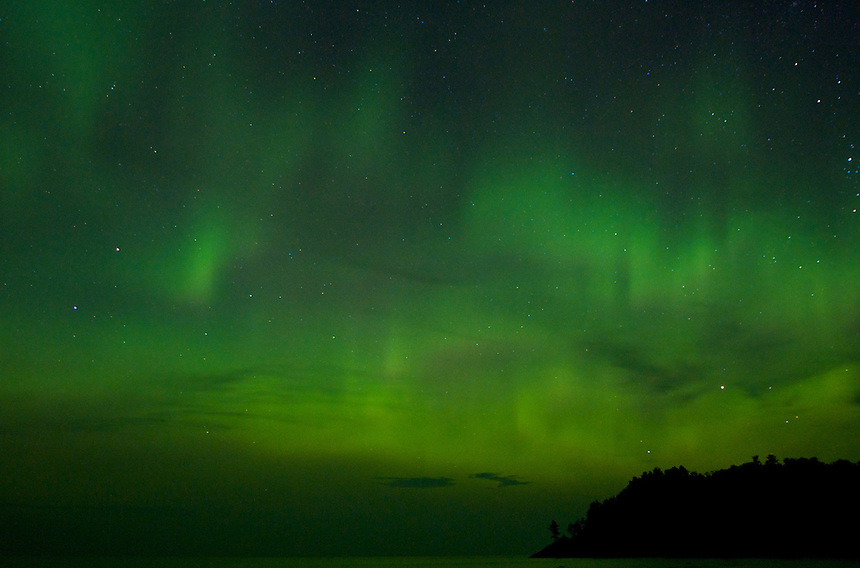 A green, colorful sky captured over Lake Superior. Northern Lights - Marquette, MI