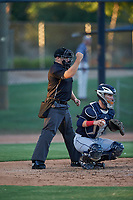 Home plate umpire Luke Morris calls a strike on a batter behind catcher Michael Amditis (8) during an Arizona League game between the AZL Indians Blue and AZL White Sox on July 2, 2019 at Camelback Ranch in Glendale, Arizona. The AZL Indians Blue defeated the AZL White Sox 10-8. (Zachary Lucy/Four Seam Images)