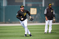 Pittsburgh Pirates Garth Brooks (7) tracks a fly ball as coach Kimera Bartee (18) looks on during the teams first Spring Training practice on February 18, 2019 at Pirate City in Bradenton, Florida.  (Mike Janes/Four Seam Images)