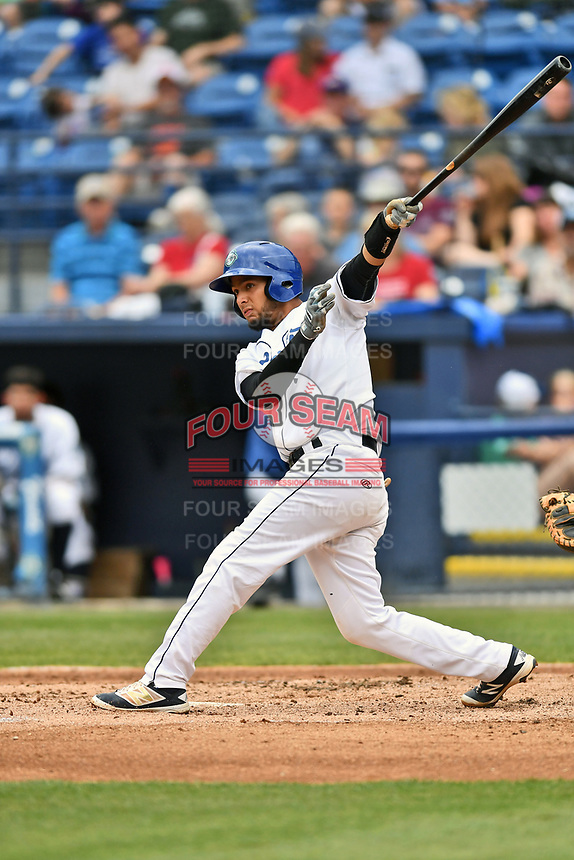 Asheville Tourists catcher Joel Diaz (5) swings at a pitch during a game against the Lexington Legends at McCormick Field on May 29, 2017 in Asheville, North Carolina. The Legends defeated the Tourists 6-2. (Tony Farlow/Four Seam Images)
