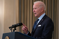 United States President Joe Biden delivers remarks on the Covid-19 response and the vaccination program from the State Dining Room of the White House in Washington, DC on Tuesday, May 4, 2021.  The President announced he will allow some governors to turn down doses they don't need or want and reallocate those doses to other states and he also set a goal of getting at least one dose of the Covid-19 vaccine to 70 percent of adults by July 4.<br /> CAP/MPI/RS<br /> ©RS/MPI/Capital Pictures