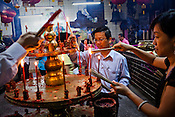Devout Chinese devotees light incense sticks at the Goddess of Mercy temple in the UNESCO heritage city of Georgetown in Penang, Malaysia. Photo: Sanjit Das/Panos