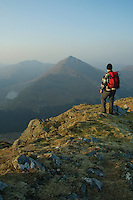 A walker looking towards Beinn an Lochan at dawn from the summit of Binnein an Fhidhlier, Arrochar Alps, Argyll & Bute<br /> <br /> Copyright www.scottishhorizons.co.uk/Keith Fergus 2011 All Rights Reserved