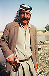 Marsh Arabs. Southern Iraq.  Marsh Arab man with gun. Haur al Mamar or Haur al-Hamar marsh collectively known now as Hammar marshes Iraq 1984