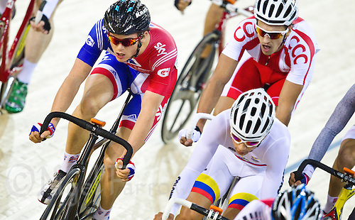 17 FEB 2012 - LONDON, GBR - Great Britain's Ben Swift (GBR) (in blue and red) keeps towards the head of the pack during the Men's Omnium Elimination Race at the UCI Track Cycling World Cup, and London Prepares test event for the 2012 Olympic Games, in the Olympic Park Velodrome in Stratford, London, Great Britain .(PHOTO (C) 2012 NIGEL FARROW)
