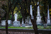 Couched among the trees, marble and granite,  monuments and headstones at the Pioneer Cemetery in the Heritage Park and Museums in Dublin, California.