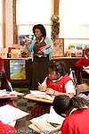 K-8 Parochial School Bronx New York Grade 5 female teacher talking to group social studies vertical