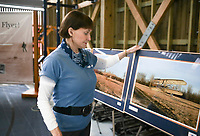 Retired pilot Connie Tobias looks at a photo from when she flew a 1903 Wright flyer in 2004, shortly after the 100-year-anniversary of when the Wright Brothers flew the iconic airplane, Monday, April 26, 2021 at the Thaden Barn in Bentonville. Tobias is the only aviator to fly controlled flight in a 1903 Wright flyer exact replica equal to the Wright Brothers flight. Tobias grew up in Dayton, Ohio the birthplace of Aviation and now lives in Kitty Hawk, North Carolina, the state of the first flight by the Wright Brothers. Now retired, she gives educational seminars at different schools with the Wright Brothers Aeroplane Co. of Dayton Ohio. Their visit to the Thaden Barn is their first educational seminar since the start of the pandemic. Check out nwaonline.com/210427Daily/ for today's photo gallery. <br /> (NWA Democrat-Gazette/Charlie Kaijo)