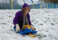 A young girl having fun sledging in the park following Heavy Snowfall at Sidcup, Kent, England on the 8 February 2021. Photo by Alan Stanford.