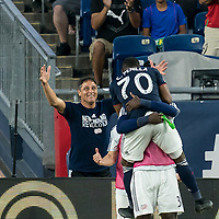 FOXBOROUGH, MA - JULY 28: Cristian Penilla #70 celebrates his goal with teammates during a game between Orlando City SC and New England Revolution at Gillette Stadium on July 27, 2019 in Foxborough, Massachusetts.