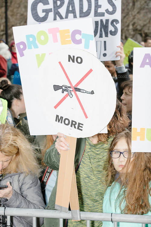 """People gather during the March For Our Lives protest and demonstration in Boston Common in Boston, Massachusetts, USA, on Sat., March 24, 2018. The march was held in response to recent school gun violence. Here a sign reads, """"No more."""""""