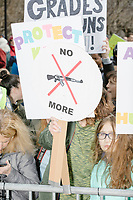 "People gather during the March For Our Lives protest and demonstration in Boston Common in Boston, Massachusetts, USA, on Sat., March 24, 2018. The march was held in response to recent school gun violence. Here a sign reads, ""No more."""