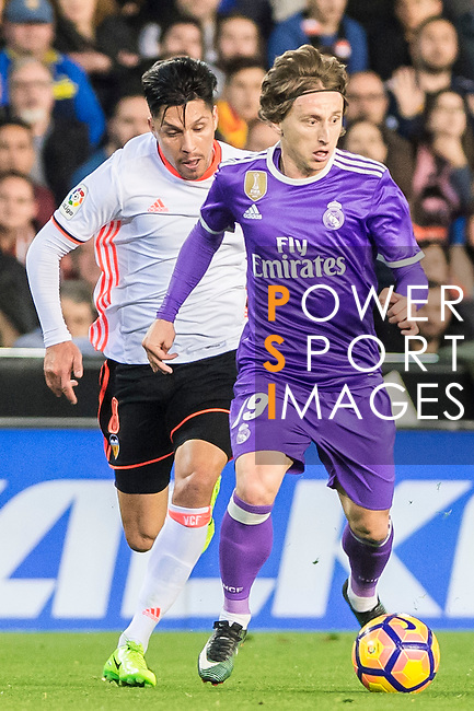 Luka Modric (r) of Real Madrid battles for the ball with Enzo Nicolas Perez of Valencia CF during their La Liga match between Valencia CF and Real Madrid at the Estadio de Mestalla on 22 February 2017 in Valencia, Spain. Photo by Maria Jose Segovia Carmona / Power Sport Images