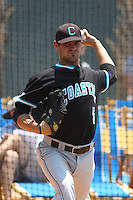 The Coastal Carolina University Chanticleers starting pitcher Cody Wheeler #5 warming up in the bullpen before the 2nd and deciding game of the NCAA Super Regional vs. the University of South Carolina Gamecocks on June 13, 2010 at BB&T Coastal Field in Myrtle Beach, SC.  The Gamecocks defeated Coastal Carolina 10-9 to advance to the 2010 NCAA College World Series in Omaha, Nebraska. Photo By Robert Gurganus/Four Seam Images