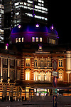 Tokyo, Japan - The dome of the Tokyo Station building reflects a pink illumination at the opening ceremony of the Tokyo Michiterasu 2013, in front of Tokyo Station on December 24, 2013. The illumination of this year presents the light wheels on light railway and the light train windows. The event starts from December 24th to 29th at around Tokyo Station. (Photo by Rodrigo Reyes Marin/AFLO)