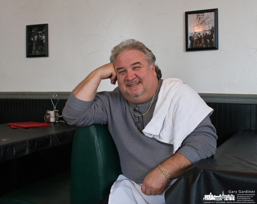 Michael Evans, owner of Michael's Pizza, relaxes in his downtown Westerville, Ohio, Italian restaurant during an afternoon lull. The restaurant was the site in 2006 for the first alcohol served in Westerville in 130 years. Photo Copyright Gary Gardiner. Not for reproduction without written permission.