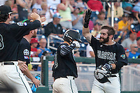 Coastal Carolina Chanticleers outfielder Anthony Marks (29) celebrates scoring a run against the Florida Gators in Game 4 of the NCAA College World Series on June 19, 2016 at TD Ameritrade Park in Omaha, Nebraska. Coastal Carolina defeated Florida 2-1. (Andrew Woolley/Four Seam Images)