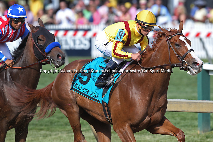 May 15, 2015: Keen Pauline leads as the horses head to the clubhouse turn, followed by Luminance (Martin Garcia). Keen Pauline, Javier Castellano up, wins the Grade II Black-Eyed Susan Stakes at Pimlico Race Course in Baltimore, MD. Trainer is Dale Romans; owner is Stonestreet Stables. Joan Fairman Kanes/ESW/CSM