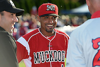 Batavia Muckdogs manager Angel Espada (4) during the lineup exchange before a game against the Auburn Doubledays on June 14, 2014 at Dwyer Stadium in Batavia, New York.  Batavia defeated Auburn 7-2.  (Mike Janes/Four Seam Images)