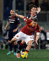 Calcio, Serie A: Roma vs Cagliari. Roma, stadio Olimpico, 1 febbraio 2013..AS Roma forward Francesco Totti, foreground, is challenged by Cagliari midfielder Albin Ekdal, of Sweden, during the Italian Serie A football match between AS Roma and Cagliari, at Rome's Olympic stadium, 1 February 2013..UPDATE IMAGES PRESS/Isabella Bonotto