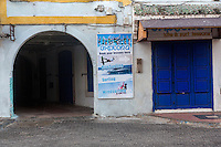 Essaouira, Morocco.  Closed Shop Doors, Early Morning in the Medina.  Sports Advertisement.
