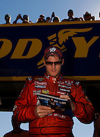 Nov 12, 2005; Phoenix, Ariz, USA;  Nascar Nextel Cup driver Dale Earnhardt Jr. signs autographs as he walks to the grid prior to qualifying for the Checker Auto Parts 500 at Phoenix International Raceway. Mandatory Credit: Photo By Mark J. Rebilas