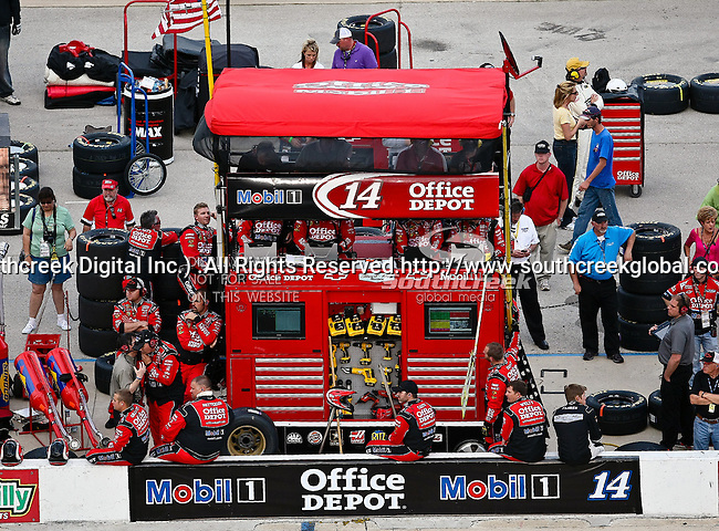 Tony Stewart's, driver of the (14) Mobil 1/Office Depot Chevrolet, pit crew awaits him during the Samsung Mobile 500 Sprint Cup race at Texas Motor Speedway in Fort Worth,Texas.