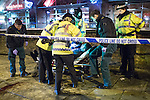 """© Joel Goodman - 07973 332324 . 20/12/2014 . Manchester , UK . Paramedics and police lift a man with a head injury on to a trolley outside Deansgate Locks nightclub venue . The ambulance took over 40 minutes to arrive . """" Mad Friday """" revellers out in the rain and cold in Manchester . Mad Friday is typically the busiest day of the year for emergency services , taking place on the last Friday before Christmas when office Christmas parties and Christmas revellers enjoy a night out .  Photo credit : Joel Goodman"""