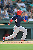 Shortstop Edwin Lora (4) of the Hagerstown Suns bats in a game against the Greenville Drive on Sunday, July 17, 2016, at Fluor Field at the West End in Greenville, South Carolina. Hagerstown won, 3-2. (Tom Priddy/Four Seam Images)