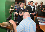 Wells Fargo's David Hehn, center, takes his turn at minting a medallion during a ceremony marking the beginning of production of the third medallion in the four-part Sesquicentennial series, at the Nevada State Museum in Carson City, Nev., on Friday, May 30, 2014. <br /> Photo by Cathleen Allison