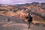 Photographer on trail, Landmannalaugar, Fjallbak Nature Reserve, Iceland