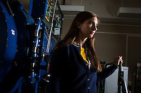 Seen here in the Space Propulsion Laboratory, Aeronautics and Astronautics Ph.D. candidate Natalya Brikner has been working on the ion Electrospray Propulsion System (iEPS) for CubeSats at MIT in Cambridge, Massachusetts, USA.  The device is used to maneuver a 10cm cubic satellite in space. Brikner, alongside fellow Ph.D. candidate Louis Perna, has formed a company, Accion Systems Incorporated, to commercialize the research. Brikner, graduating in Winter 2014, is CEO of the company, and Perna is co-founder. The research at MIT was done under Space Propulsion Lab director Paulo Lozano, professor in MIT's Department of Aeronautics and Astronautics.