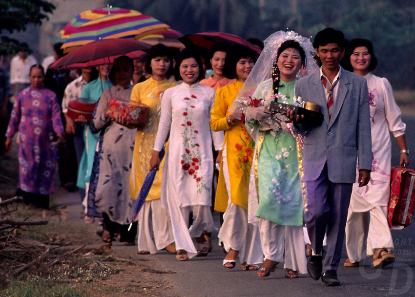 A Vietnamese wedding party on the main road in the Mekong Delta Area