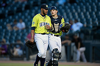 Starting pitcher Simeon Woods-Richardson (21) of the Columbia Fireflies walks off the field with catcher Hayden Senger (15) after qualifying for the 5-2 win in a game against the Augusta GreenJackets on Thursday, July 11, 2019 at Segra Park in Columbia, South Carolina. (Tom Priddy/Four Seam Images)